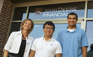 Three people in front of John Deere Financiel