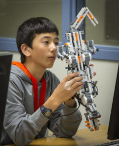 Middle Schooler with Robot